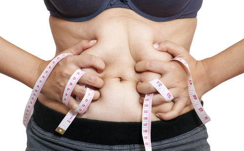 woman's expanding waistline